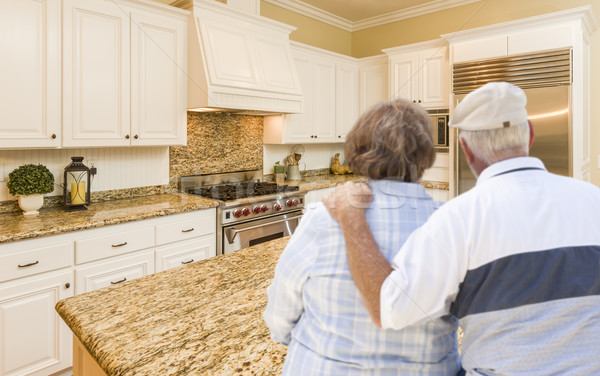 Senior Couple Looking Over Beautiful Custom Kitchen Stock photo © feverpitch