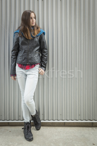 Young Teen Girl Standing Against Metal Wall Stock photo © feverpitch