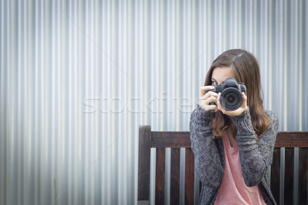 Girl Photographer Sitting and Pointing Camera Stock photo © feverpitch