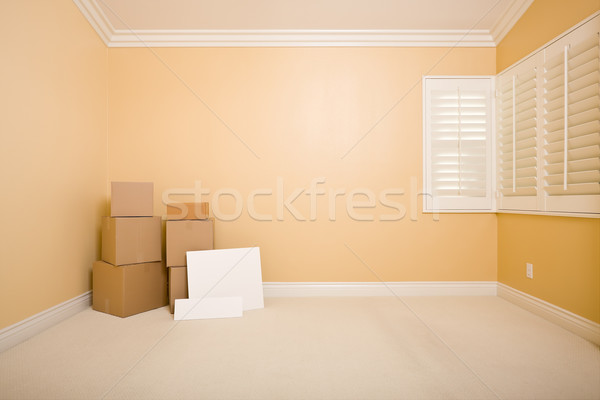 Moving Boxes and Blank Signs on Floor in Empty Room  Stock photo © feverpitch