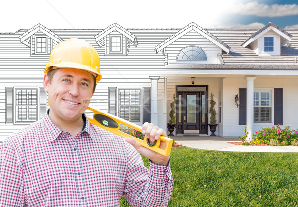 Male Contractor Wearing Hard Hat In Front of House Drawing Grada Stock photo © feverpitch