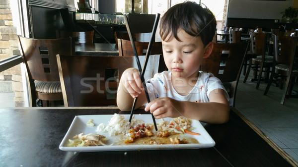 Cute młodych chińczyk chłopca nauki Zdjęcia stock © feverpitch