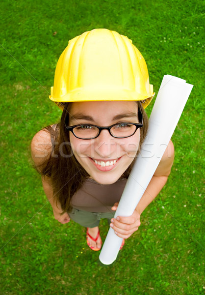 Femenino arquitecto jóvenes sonriendo constructor Foto stock © filmstroem