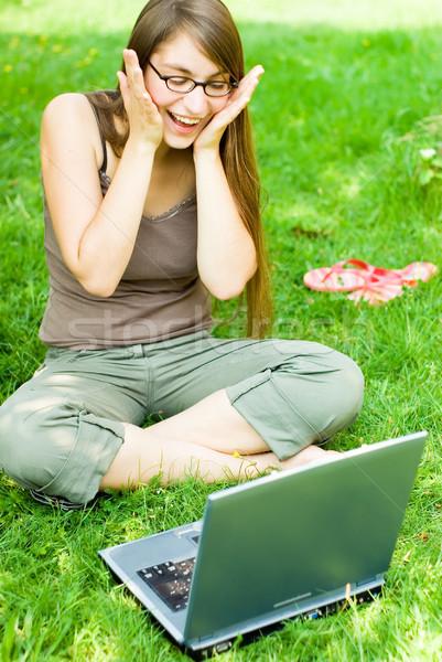 счастливая девушка за пределами ноутбука портрет счастливым Сток-фото © filmstroem