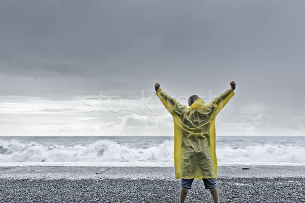 Man standing against the ocean Stock photo © filmstroem