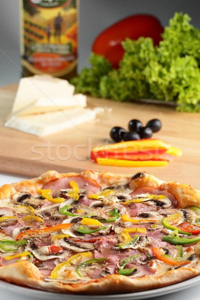 Sıcak pizza lezzetli biber zeytin peynir Stok fotoğraf © fiphoto