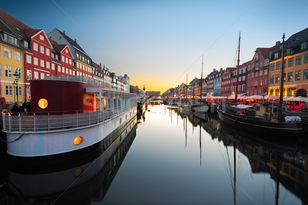 Ships in Nyhavn at sunset, Copenhagen, Denmark Stock photo © fisfra