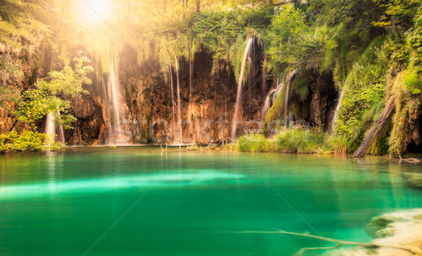 Waterfall with sun at Plitvice Lakes National Park, Croatia Stock photo © fisfra
