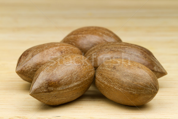 Pecans with beige background Stock photo © fisfra