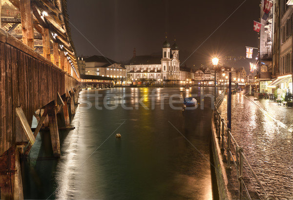 Chapel Bridge (Kappelbrücke) with Jesuit Chruch at night, Lucerne, Switzerland Stock photo © fisfra