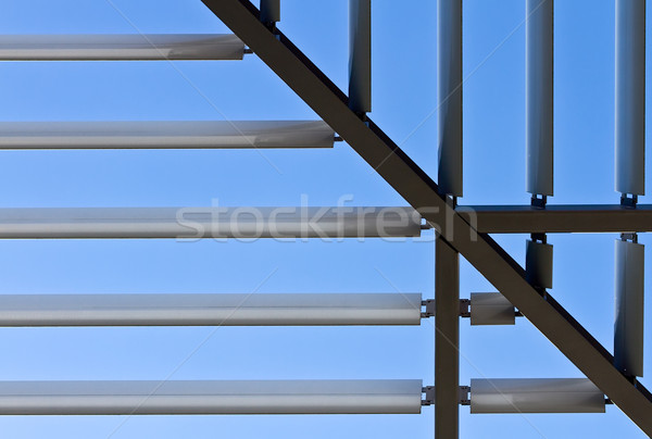 Symmetric roof made of steel with lights and shadows Stock photo © fisfra
