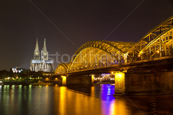 Cologne Cathedral and Hohenzollern Bridge at night, Cologne (Koeln), Germany Stock photo © fisfra