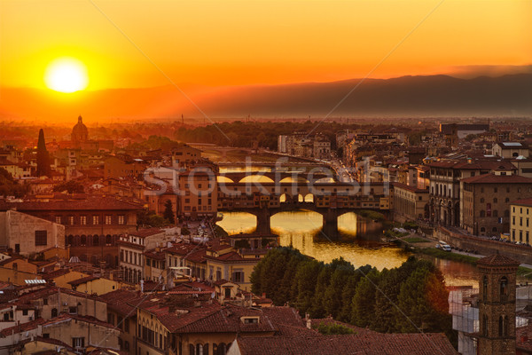 Florence, Arno River and Ponte Vecchio at sunset, Italy Stock photo © fisfra