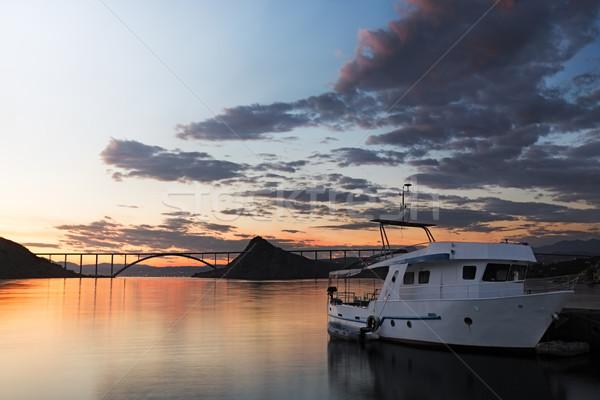 Kirk bridge with ship at sunset, Croatia Stock photo © fisfra