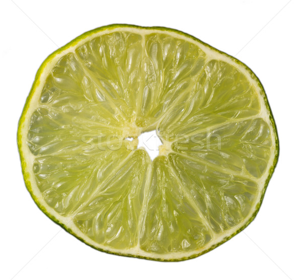 Slice of an isolated green lemon (lat. Citrus) - 'Eureka' Stock photo © fisfra