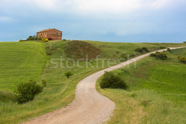 Tuscany farmhouse with lightning at horizon, Pienza, Italy Stock photo © fisfra