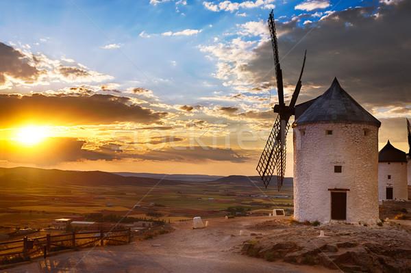 Windmill at sunset, Consuegra, Spain Stock photo © fisfra