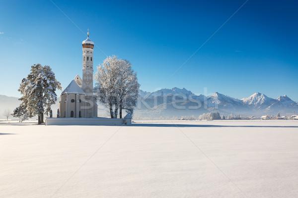 St. Coloman at a sunny winter day, Allgäu, Germany Stock photo © fisfra