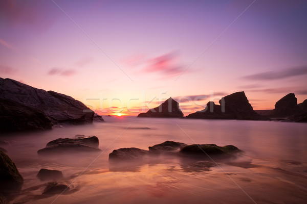 Bedruthan Steps at sunset with violet skies, Cornwall, England Stock photo © fisfra