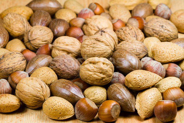 Stock photo: Mixed nuts (hazelnuts, walnuts, shell almonds, pecans)