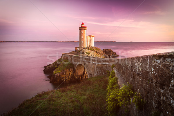 Lighthouse Phare du Petit Minou at sunset, Brittany, France Stock photo © fisfra