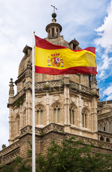 Toledo Cathedral with Spanish flag Stock photo © fisfra