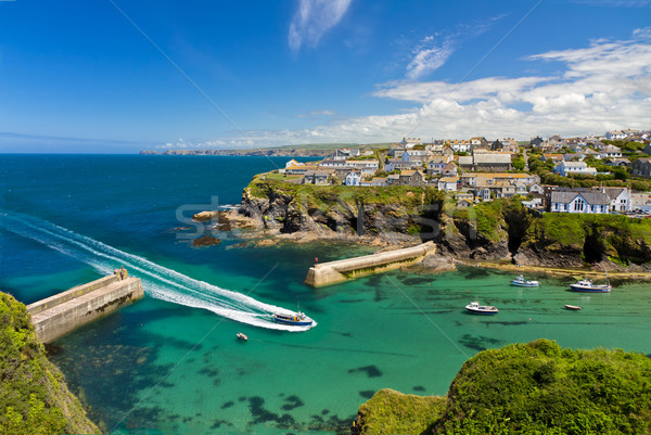 Cove and harbour of Port Isaac with arriving ship, Cornwall, England Stock photo © fisfra