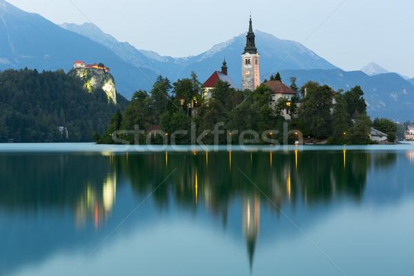 Sziget kastély alkonyat Szlovénia víz erdő Stock fotó © fisfra