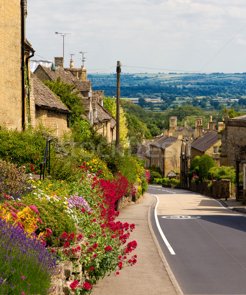Cotswolds village Bourton-on-the-Hill with flowers, UK Stock photo © fisfra