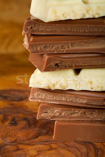 Chocolate stack of dark and white chocolate with brown background Stock photo © fisfra