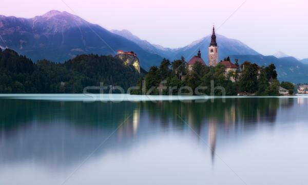 Tó este fény Szlovénia égbolt víz Stock fotó © fisfra