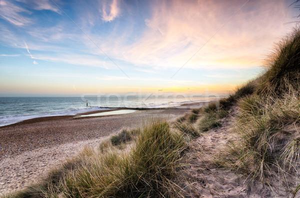 Coucher du soleil sable tête plage ciel herbe Photo stock © flotsom