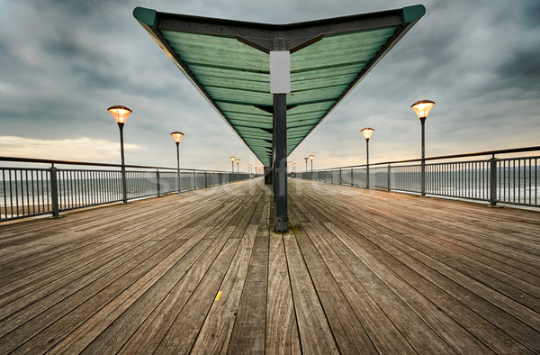 Pier avond strand hout landschap zee Stockfoto © flotsom