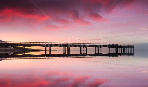 Pier plage eau coucher du soleil paysage mer Photo stock © flotsom
