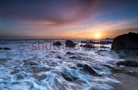 Sunrise océan ciel nuages coucher du soleil paysage Photo stock © flotsom