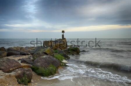 Zee golven hoofd strand hemel zonsondergang Stockfoto © flotsom