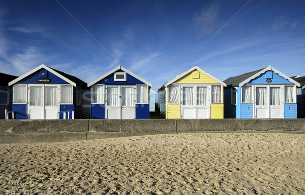 Row of brightly coloured beach huts Stock photo © flotsom