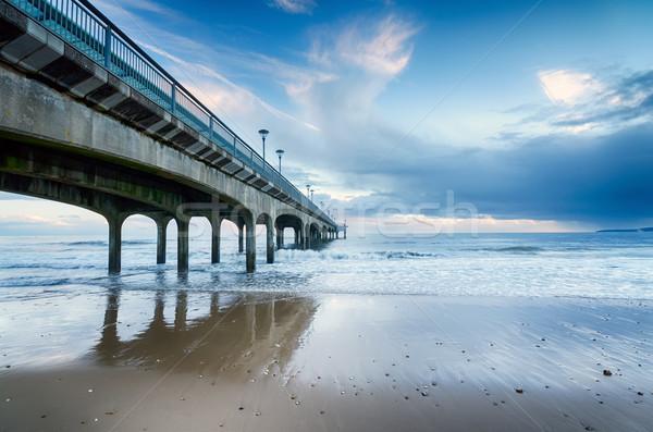 Surfen pier strand hemel wolken zee Stockfoto © flotsom