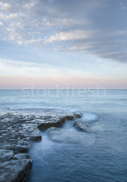 Océan coucher du soleil vagues roches plage paysage Photo stock © flotsom