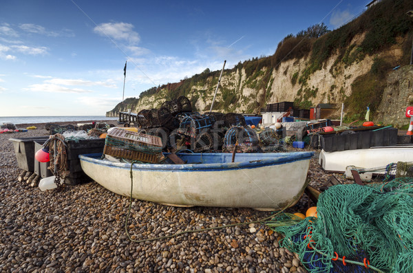 Fishing boat and nets on the beach in Devon Stock photo © flotsom