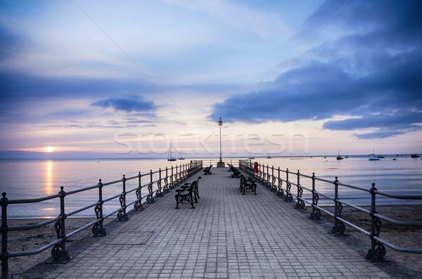 Zonsopgang pier zomer lege water wolken Stockfoto © flotsom