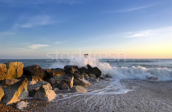 Golven rotsen zee strand hoofd zonsondergang Stockfoto © flotsom