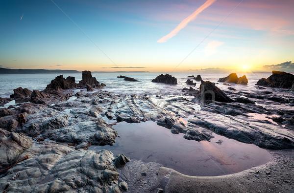 Rock plage coucher du soleil nature mer Voyage Photo stock © flotsom