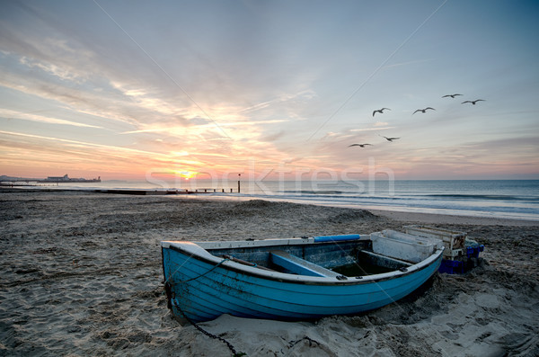 Blue Boat on Beach at Sunrise Stock photo © flotsom