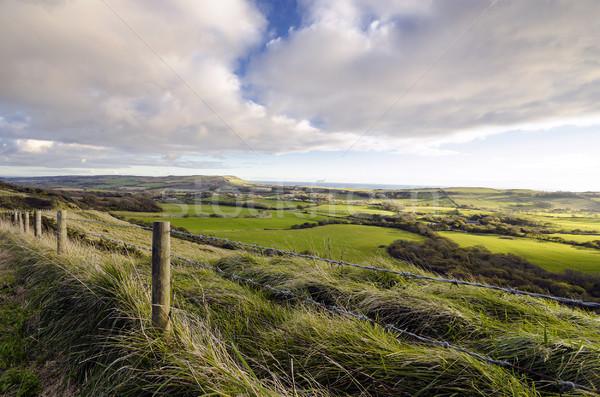 Platteland wolken groene Engeland velden heuvels Stockfoto © flotsom
