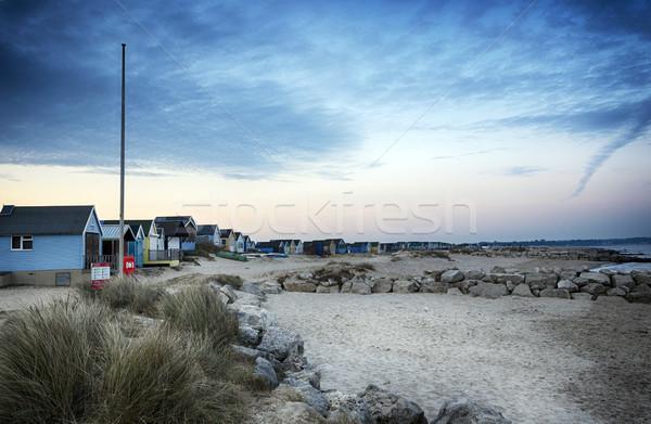 Plage crépuscule cracher tête maison coucher du soleil Photo stock © flotsom