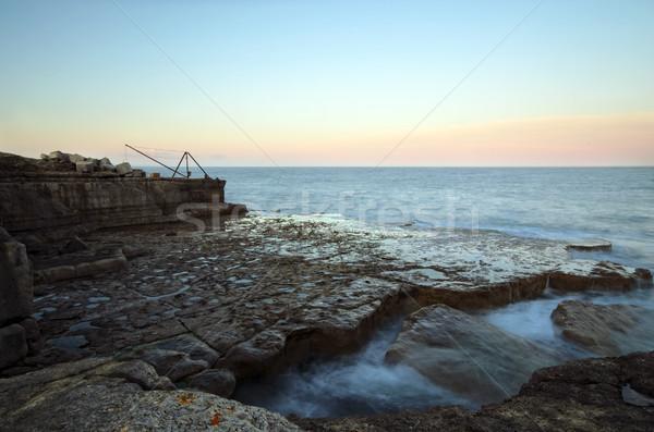 законопроект лодка закат морем волны пород Сток-фото © flotsom