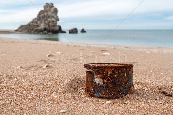 Rusty tin can on the beach Stock photo © fogen