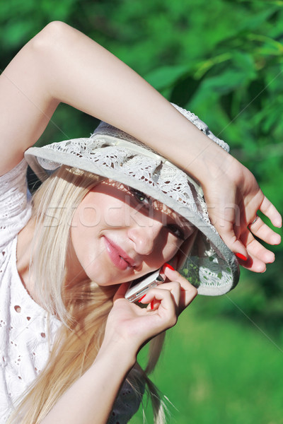 говорить мобильного телефона красивой сотового телефона лице Сток-фото © fogen