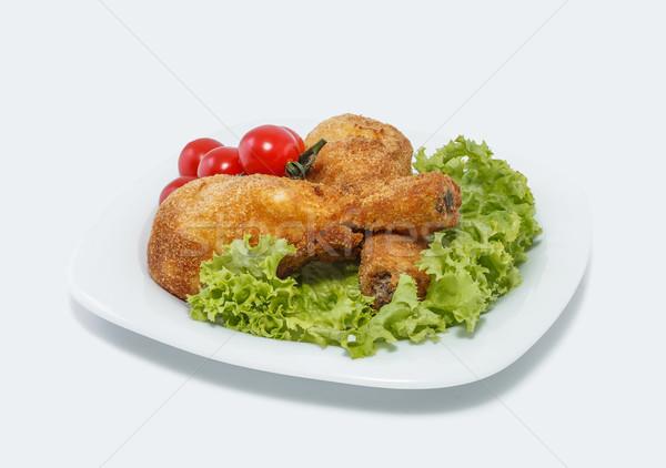 Coated with breadcrumbs chicken legs Stock photo © fogen